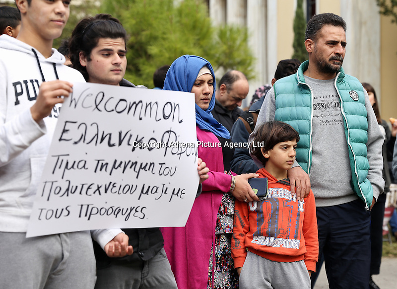 Pictured: Refugees join the anniversary at the Athens Polytechinc in Athens Greece. Wednesday 16 November 2016<br /> Re: 43rd anniversary of the Athens Polytechnic uprising of 1973 which was a massive demonstration of popular rejection of the Greek military junta of 1967–1974. The uprising began on November 14, 1973, escalated to an open anti-junta revolt and ended in bloodshed in the early morning of November 17 after a series of events starting with a tank crashing through the gates of the Polytechnic.