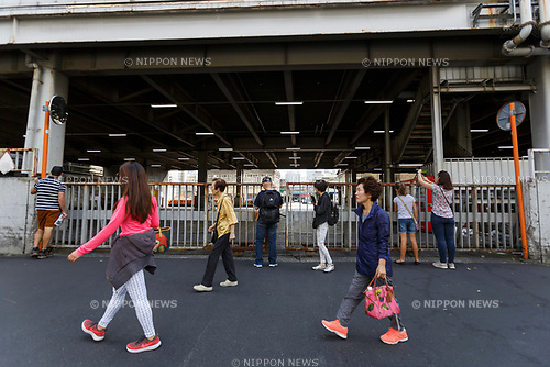 Tourists walk past Tokyo's Tsukiji Wholesale Fish Market on October 10, 2018, Tokyo, Japan. Tokyo's iconic fish market closed its doors for the last time on October 6 for a move to a newly created facility, ''The Toyosu Fish Market,'' which will start operating on October 16. The wholesale fish market in Tsukiji first opened in the mid-1930s and was one of the Japanese capital's most popular destinations for international tourists. (Photo by Rodrigo Reyes Marin/AFLO)