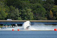 Frame 3: Dan Orchard, (#97) spins and rolls over in the East Turn. (SST-120 class)