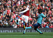 9th September 2017, Emirates Stadium, London, England; EPL Premier League Football, Arsenal versus Bournemouth; Mesut Ozil of Arsenal with a volley shot past Nathan Ake of Bournemouth