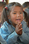 A girl sings a song in a class in Pida, a village in Nepal's Dhading District where the United Methodist Committee on Relief (UMCOR), a member of the ACT Alliance, is helping families to rebuild their lives in the wake of the 2015 earthquake that ravaged much of Nepal.