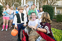 Mollie Montgomery, a junior educational psychology major from Flowood, passes out candy with her Zeta Tau Alpha sorority sisters during Trick-or-Treat on Sorority Row. Reed Sparks, seen here as Han Solo, was one of the many children to take advantadge of the trick-or-treating opportunity at MSU. He was joined by his trusted sidekick, Humphrey, seen here as Chewbacca.<br />  (photo by Beth Wynn / &copy; Mississippi State University)
