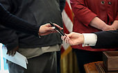 """United States President Donald J. Trump gives a pen after he signed an Executive Order to strengthen the Trump Administration's """"Buy American"""" policy by encouraging recipients of Federal financial assistance for infrastructure to """"Buy American"""" in the Oval Office of the White House on January 31, 2019 in Washington, DC. <br /> Credit: Oliver Contreras / Pool via CNP"""