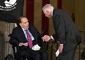 United States House Minority Whip Steny Hoyer (Democrat of Maryland), right, shakes hands with former US Senator Bob Dole (Republican of Kansas), left, after making remarks at a Congressional Gold Medal ceremony honoring Dole that was also attended by US President Donald J. Trump in the Rotunda of the US Capitol on Wednesday, January 17, 2017.  Congress commissioned gold medals as its highest expression of national appreciation for distinguished achievements and contributions.  Dole served in Congress from 1961 through 1996, was the Senate GOP leader from 1985 through 1996, and was the 1996 Republican Party nominee for President of the United States.<br /> Credit: Ron Sachs / CNP