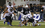 Nevada's Jonathan McNeal (50) dives on a loose ball against Boise State during the second half of an NCAA college football game in Reno, Nev., on Saturday, Oct. 4, 2014. From left, Boise State's Marcus Henry (72) Travis Averill (73), Nevada's Rykeem Yates (55) and Boise State's Grant Hedrick (9) were also in on the play in which Yates forced Hedrick to fumble. Boise State won 51-46. (AP Photo/Cathleen Allison)