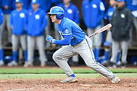 First baseman Troy Squires (16) of the Kentucky Wildcats bats in a game in the rain against the University of South Carolina Upstate Spartans on Saturday, February 17, 2018, at Cleveland S. Harley Park in Spartanburg, South Carolina. Kentucky won, 6-5, in 10 innings. (Tom Priddy/Four Seam Images)