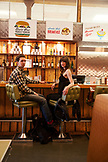 CANADA, Vancouver, British Columbia, A local couple dine at the counter, Save On Meats Restaurant located on West Hastings Street