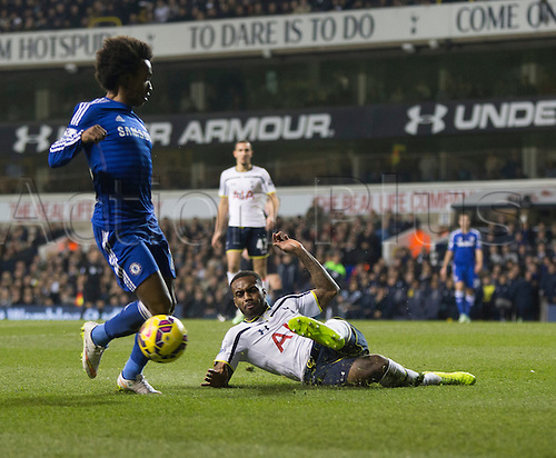 01.01.2015.  London, England. Barclays Premier League. Tottenham versus Chelsea. Tottenham Hotspur's Danny Rose slides in to win the ball against Chelsea's Willian.