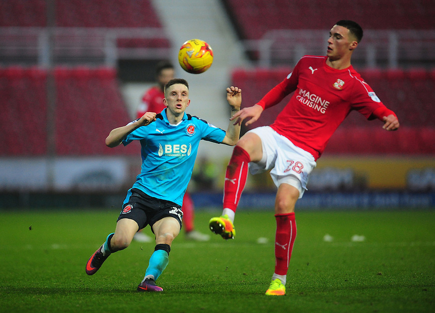 Swindon Town's Lloyd Jones under pressure from Fleetwood Town's Ashley Hunter<br /> <br /> Photographer Kevin Barnes/CameraSport<br /> <br /> The EFL Sky Bet League One - Swindon Town v Fleetwood Town - Saturday 17th December 2016 - County Ground - Swindon<br /> <br /> World Copyright &copy; 2016 CameraSport. All rights reserved. 43 Linden Ave. Countesthorpe. Leicester. England. LE8 5PG - Tel: +44 (0) 116 277 4147 - admin@camerasport.com - www.camerasport.com