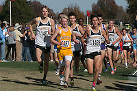 Four Lafayette runners run in the lead pack just before the mile mark in the Class 4 Boys race at the 2015 MSHSAA State Cross Country Championships in Jefferson City, Saturday, November 7. The group includes Austin Hindman (1467), Alec Haines (center), Devin Meyrer (1469), and Dylan Quisenberry (1471).