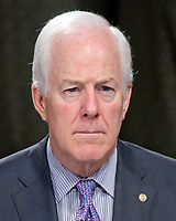 """United States Senator John Cornyn (Republican of Texas)  listens to the testimony during the US Senate Select Committee on Intelligence as it conducts an open hearing titled """"Disinformation: A Primer in Russian Active Measures and Influence Campaigns"""" on Capitol Hill in Washington, DC on Thursday, March 30, 2017. Photo Credit: Ron Sachs/CNP/AdMedia"""