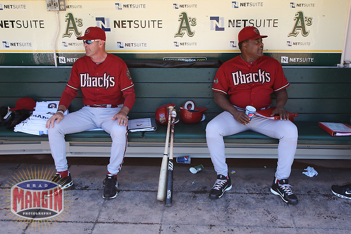 OAKLAND, CA - JULY 3:  Manager Kirk Gibson #23 and batting coach Don Baylor #25 of the Arizona Diamondbacks sit in the dugout before the game against the Oakland Athletics at the Oakland-Alameda County Coliseum on July 3, 2011 in Oakland, California. Photo by Brad Mangin
