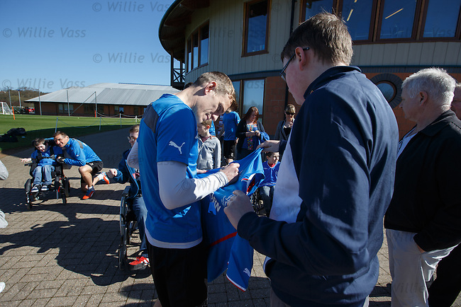 Dean Shiels signs some tops