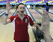 "Shannon Westfall, Holly, gets high fives from teammates after throwing a strike against Lakeland in the finals match of the Oakland County Girls Bowling Championship at Thunderbird Lanes in Troy Sunday, Jan. 20, 2013. Oakland County Girls Bowling Championship at Thunderbird Lanes, January 20, 2013. Photos: Larry McKee, L McKee Photography. L McKee Photography, Clarkston, Michigan. L McKee Photography, specializing in college and high school varsity action sports and senior portrait photography. Other L McKee Photography services include business profile, commercial, event and editorial photography. L McKee Photography, serving Oakland County, Genesee County, Livingston County and Wayne County, Michigan. L McKee Photography your ""professional"" source for college and high school varsity action sports and senior portrait photography."