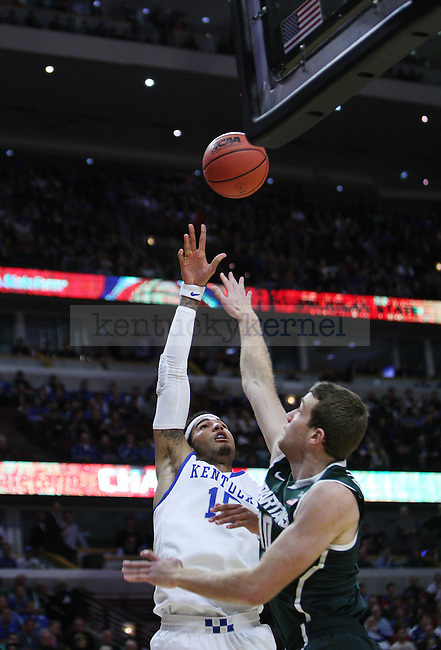 Kentucky Wildcats forward Willie Cauley-Stein (15) and Michigan State Spartans forward Matt Costello (10) fight for the ball during the first half of UK men's basketball vs. Michigan State at United Center in Chicago, Ill., at the Champions Classic  on Tuesday, November 12, 2013. Photo by Emily Wuetcher | Staff