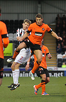 David van Zanten (left) and John Rankin challenge in the St Mirren v Dundee United Clydesdale Bank Scottish Premier League match played at St Mirren Park, Paisley on 27.10.12.