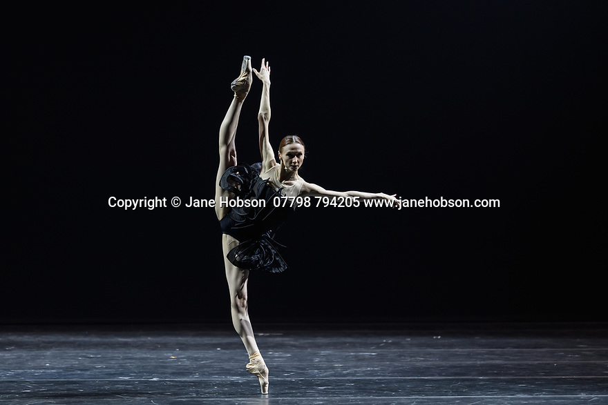 "London, UK. 02.12.19. Svetlana Zakharova, the Bolshoi's Prima and the first and only Russian Etpile at Teatro alla Scala, returns to the London Coliseum, with MODANSE, a new double bill produced by Muzarts. Zakharova is joined on stage by a cast of dancers from the Bolshoi Ballet, including Mikhail Lobukhin, Vaycheslav Lopatin, Denis Savin, Jacopo Tissi and Ana Turazashvili. The piece shown is: 'Come un Respiro"" (Like a Breath), choreographed by Mauro Bigonzetti, in its UK premiere. The dancers are: Svetlana Zakharova, Denis Savin, Jacopo Tissi, Mikhail Lobukhin, Vyacheslav Lopatin, Ana Turazashvili, Anastasia Stashkevich, Victoria Litvinova, Marfa Fyodorova, Tatiana Osipova, Anita Pudikova, Anna Zakaraya, Karim Abdullin, Alexei Gaynutdinov, Anton Gaynutdinov. Picture shows: Svetlana Zakharova. Photograph © Jane Hobson."