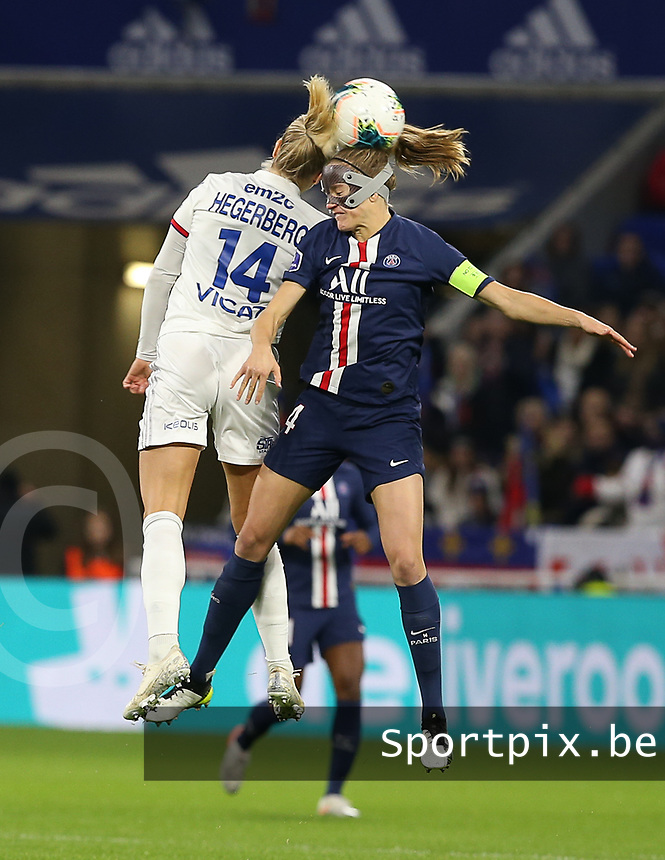 20191116 – LYON ,  FRANCE ; Lyon's  Ada Hegerberg (14) and PSG's Irene Paredes battle for a high ball during the women's soccer game between Olympique Lyonnais and PARIS SG on the 9th matchday of the French Women's first league , D1 of the 2019-2020 season , Saturday 16 th November 2019 at the Groupama stadium in Lyon , France . PHOTO SPORTPIX.BE | SEVIL OKTEM