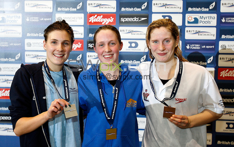 PICTURE BY VAUGHN RIDLEY/SWPIX.COM...Swimming - British Gas Swimming Championships 2011, Day 8 - Manchester Aquatics Centre, Manchester, England - 12/03/11...Womens 400m Individual Medley Final - (L-R) Silver - Kate Hutchinson, Gold - Hannah Miley, Bronze - Emma Smithurst.