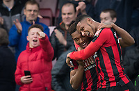 Lys Mousset of AFC Bournemouth congratulates winning goal scorer Jordon Ibe of AFC Bournemouth during the Premier League match between Bournemouth and Arsenal at the Goldsands Stadium, Bournemouth, England on 14 January 2018. Photo by Andy Rowland.