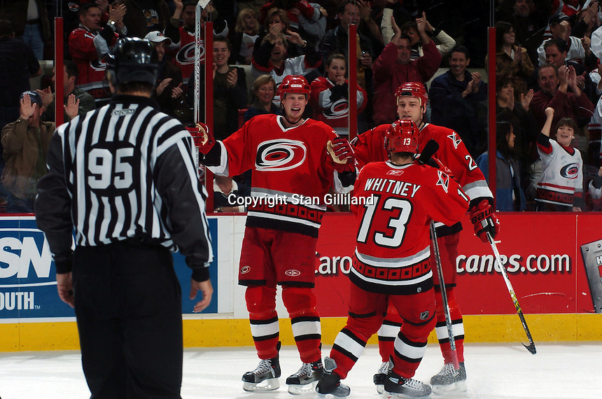 The Carolina Hurricanes' Eric Staal, left, celebrates his goal with teammates Ray Whitney (13) and Andrew Hutchinson, right, during their game against the New York Islanders Thursday, Jan. 19, 2006 in Raleigh, NC. Carolina won 4-3.
