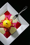 Food at L'Atelier in Boulder for the Dining Guide.  Saffron poached pear with rasberry coulis, prickly pear coulis, and creme anglais. March 5, 2007.   (ELLEN JASKOL/ROCKY MOUNTAIN NEWS).***