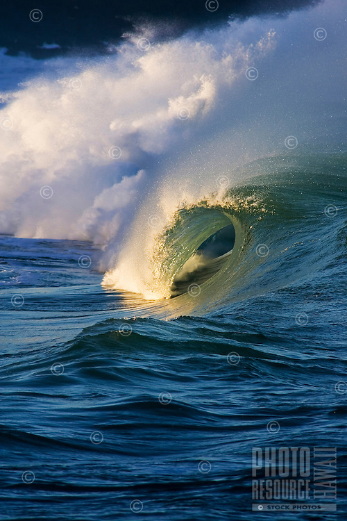 Vertical image of a wave at Waimea Bay shore break on the island of Oahu, Hawaii.