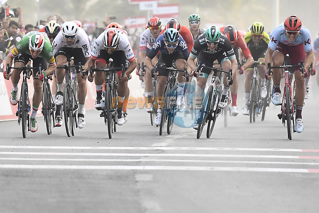 Italian National Champion Elia Viviani (ITA) Deceuninck-Quick Step outsprints Fernando Gaviria (COL) UAE Team Emirates and Sam Bennett (IRL) Bora-Hansgrohe to win Stage 5 of the 2019 UAE Tour, running 181km form Sharjah to Khor Fakkan, Dubai, United Arab Emirates. 28th February 2019.<br /> Picture: LaPresse/Fabio Ferrari | Cyclefile<br /> <br /> <br /> All photos usage must carry mandatory copyright credit (© Cyclefile | LaPresse/Fabio Ferrari)