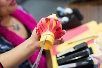 People make paper lantern crafts during a Lunar New Year celebration in the Asian American Connections Center at Middlesex Community College in Lowell, Mass., USA, on Thurs., Feb. 15, 2018.  The Asian American Connections Center was established at the school using a federal grant in 2016 and serves as a focal point for the Asian community at the school, predominantly Cambodian, to gather, socialize, study, and otherwise take part in student life.