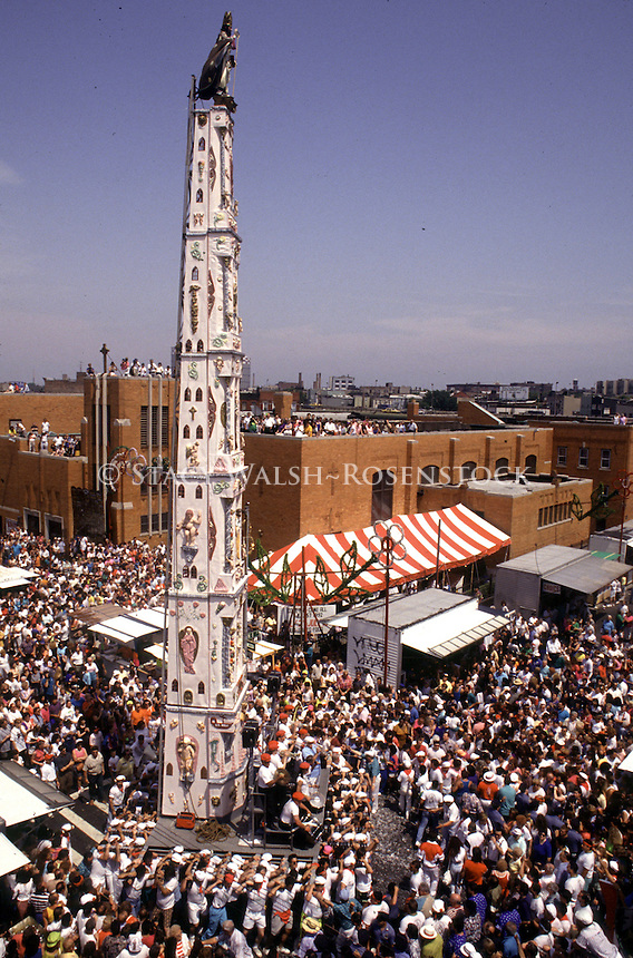 Brooklyn, NY -- 120 Italian American Male Parishioners carry the Giglio during the Feast of Our Lady of Carmel. The 80 foot two ton tower features an eight man band on the base which plays Italian songs during the annual Dance of the Giglio in Williamsburg.