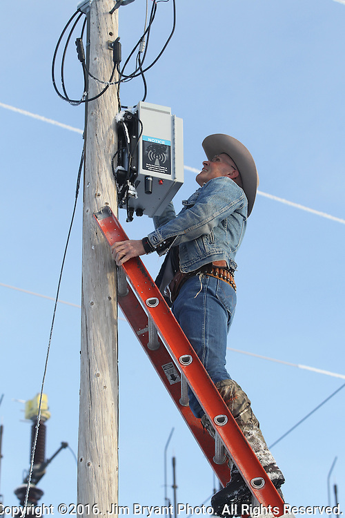 Activists LaVoy Finicum removes two FBI surveillance cameras found at a power station near the Malheur National Wildlife Reserve on January 15, 2016 in Burns, Oregon.  Ammon Bundy and about 20 other protesters took over the refuge on Jan. 2 after a rally to support the imprisoned local ranchers Dwight Hammond Jr., and his son, Steven Hammond. Another surveillance camera was found near the reserve.   ©2016. Jim Bryant Photo. All Rights Reserved.