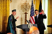 United States President Barack Obama, right, and President Hamid Karzai of Afghanistan, left, wave to reporters after conducting a joint press conference with  in the East Room of the White House in Washington, DC on Wednesday, May 12, 2010..Credit: Ron Sachs / CNP