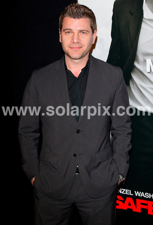 "**ALL ROUND PICTURES FROM SOLARPIX.COM**                                             **SYNDICATION RIGHTS FOR UK, AUSTRALIA, DENMARK, PORTUGAL, S. AFRICA, SPAIN & DUBAI (U.A.E) & ASIA (EXCLUDING JAPAN) ONLY**                                                                                  Arrivals at the ""Safe House"" World Movie Premiere at the School of Visual Arts (SVA ) Theatre, New York City, NY, USA.                                                                          .This pic:    Tom Murro                                                                                    JOB REF:  14454     PHZ Norfleet    DATE:  07.02.12                                                           **MUST CREDIT SOLARPIX.COM OR DOUBLE FEE WILL BE CHARGED**                                                                      **MUST AGREE FEE BEFORE ONLINE USAGE**                               **CALL US ON: +34 952 811 768 or LOW RATE FROM UK 0844 617 7637**"