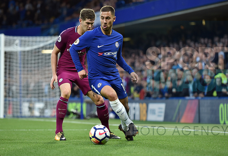 Eden Hazard of Chelsea is challenged by John Stones of Manchester City during the premier league match at the Stamford Bridge stadium, London. Picture date 30th September 2017. Picture credit should read: Robin Parker/Sportimage