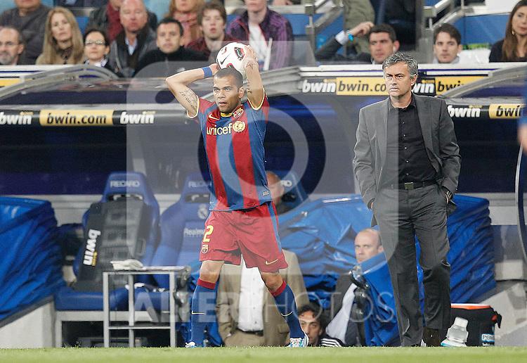 Real Madrid's Jose Mourino and FC Barcelona's Daniel Alves during la Liga match on April 16th 2011...Photo: Cesar Cebolla / ALFAQUI