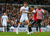 Leeds United's Kalvin Phillips battles with Brentford's Nico Yennaris<br /> <br /> Photographer Alex Dodd/CameraSport<br /> <br /> The EFL Sky Bet Championship - Leeds United v Brentford - Saturday 6th October 2018 - Elland Road - Leeds<br /> <br /> World Copyright &copy; 2018 CameraSport. All rights reserved. 43 Linden Ave. Countesthorpe. Leicester. England. LE8 5PG - Tel: +44 (0) 116 277 4147 - admin@camerasport.com - www.camerasport.com