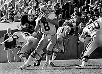New Orleans quarterback Archie Manning #8, Raiders Ted Hendricks..1975 photo/Ron Riesterer.