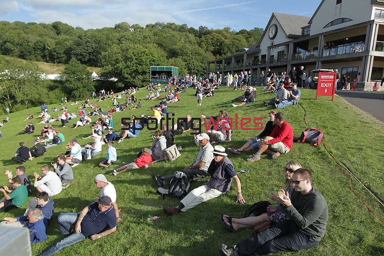 Spectators enjoying the golf and sunshine in front of the Twenty Ten clubhouse during the 3rd round of ISPS Handa Wales Open 2013 at the Celtic Manor Resort.<br /> <br /> 31.08.13<br /> <br /> &copy;Steve Pope-Sportingwales