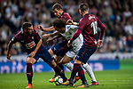 Marcelo Vieira Da Silva (c) of Real Madrid fights for the ball with David Rodriguez Lomban (l), Cristian Rivera Hernandez (back) and Anaitz Arbilla Zabala (r) of SD Eibar during the La Liga 2017-18 match between Real Madrid and SD Eibar at Estadio Santiago Bernabeu on 22 October 2017 in Madrid, Spain. Photo by Diego Gonzalez / Power Sport Images