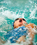 JCC's Lexie Delquadro competes in the 50 yard back race during the 53rd annual Country Club Swimming Championships on Tuesday, Aug. 7, 2012, in Kearns, Utah. (© 2012 Douglas C. Pizac)