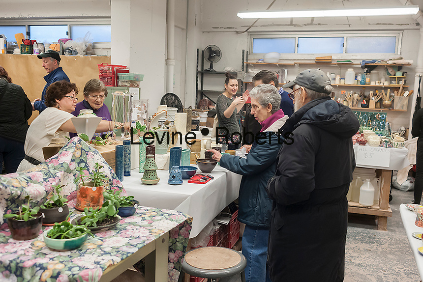 Shoppers browse pottery at a ceramics studio holiday sale in the New York neighborhood of Chelsea prior to Christmas on Saturday, December 6, 20142. (© Richard B. Levine)