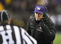 Head coach Chris Petersen signals to the referee.