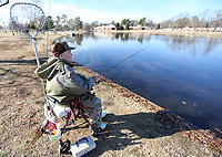 NWA Democrat-Gazette/DAVID GOTTSCHALK Melvin Binam fishes for trout Monday, December 2, 2019, at Murphy Park in Springdale. The lake was recently stocked with trout by the Arkansas Game and Fish Commission. Binam spent his morning in Springdale and then went to Lake Fayetteville to fish for crappie and brim.