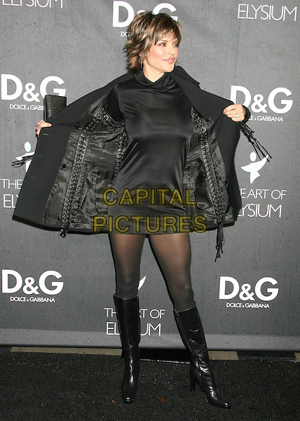 LISA RINNA .Boutique Opening Benefiting The Art of Elysium held at the Dolce & Gabana Boutique on Roberston Blvd, Beverly Hills, California, USA..December 15th, 2008.full length black dress coat jacket tights boots opening removing taking off .CAP/ADM/MJ.©Michael Jade/AdMedia/Capital Pictures.