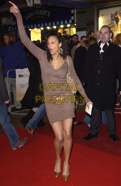 "ALESHA BUCHANAN.""Be Cool"" Premiere Leicester Square, London, WC2.March 7th, 2005.full length brown dress brown belt arm in air gesture sweat patch .www.capitalpictures.com.sales@capitalpictures.com.© Capital Pictures."