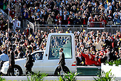 Washington, DC - April 17, 2008 -- Pope Benedict XVI waves to the faithful as he rides around Nationals Park in the Popemobile prior to celebrating Mass in Washington, D.C. on Thursday, April 17, 2008. This is the first non-baseball event in the park, which opened March 31..Credit: Ron Sachs / CNP.(RESTRICTION: NO New York or New Jersey Newspapers or newspapers within a 75 mile radius of New York City)