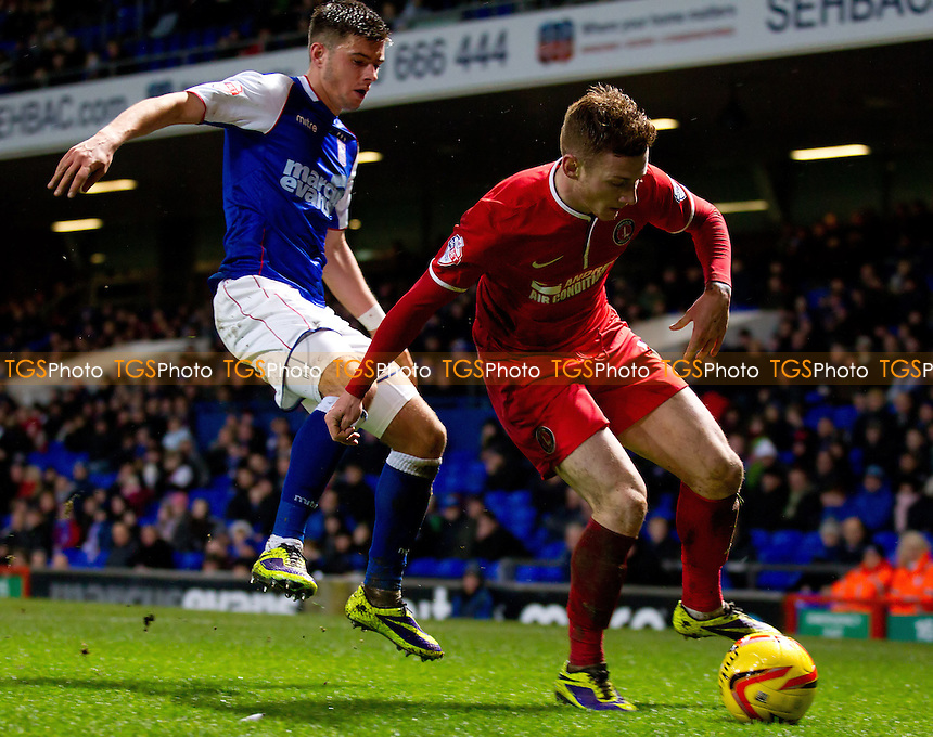 Jordan Cook of Charlton Athletic holds the ball up under pressure from Aaron Cresswell of Ipswich Town - Ipswich Town vs Charlton Athletic - Sky Bet Championship Football at Portman Road, Ipswich, Suffolk - 01/01/14 - MANDATORY CREDIT: Ray Lawrence/TGSPHOTO - Self billing applies where appropriate - 0845 094 6026 - contact@tgsphoto.co.uk - NO UNPAID USE