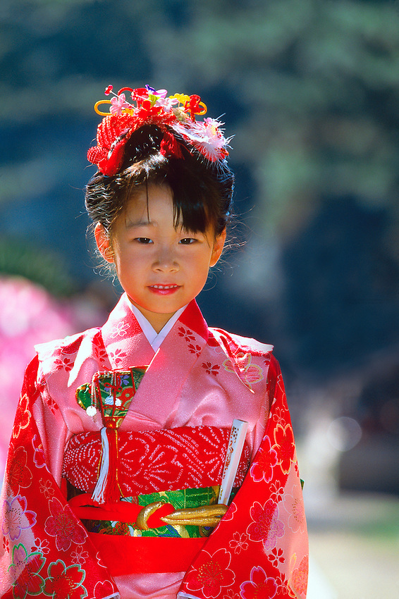 7 year old girl (Seven-five-three festival) wearing kimono, Kitano-tenmangu Shrine, Kyoto, Japan