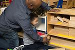Education preschool male SEIT working with boy in classroom