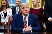 US President Donald J. Trump (C) participates in a signing ceremony for 'H.R. 724, the Preventing Animal Cruelty and Torture Act', in the Oval Office of the White House in Washington, DC, USA, 25 November 2019.<br /> Credit: Michael Reynolds / Pool via CNP